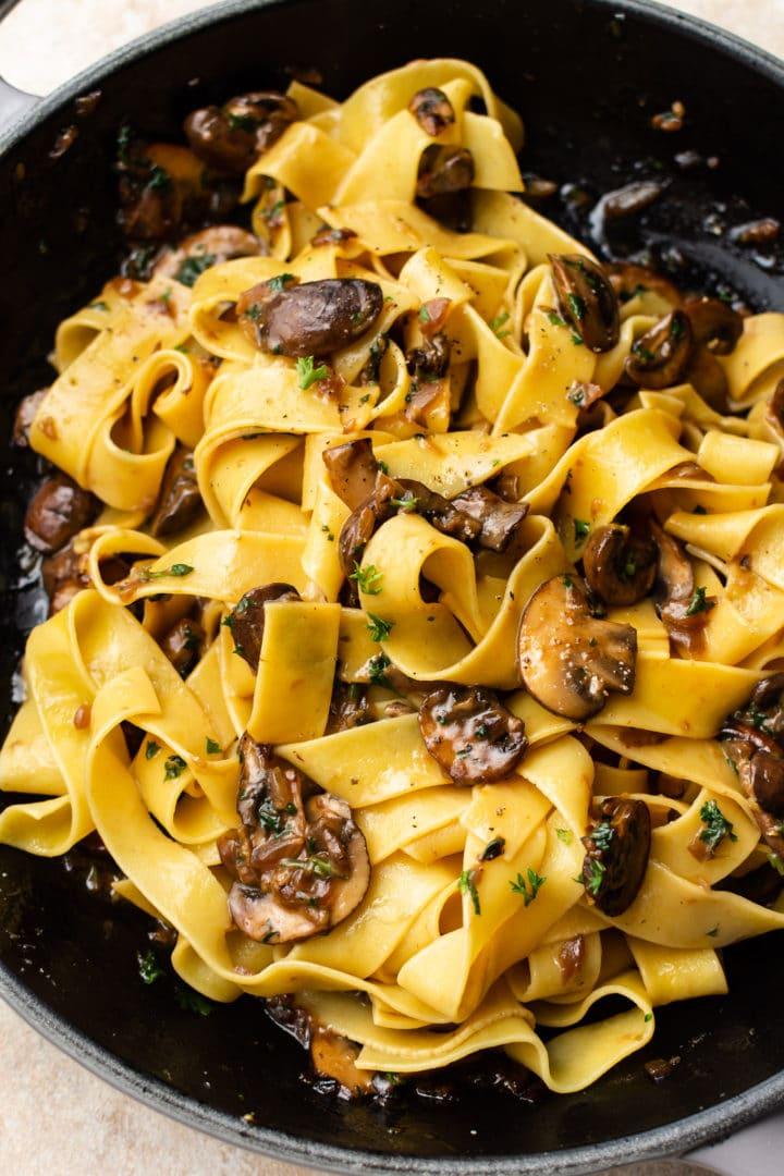 close-up of garlic mushroom pasta (in a skillet)