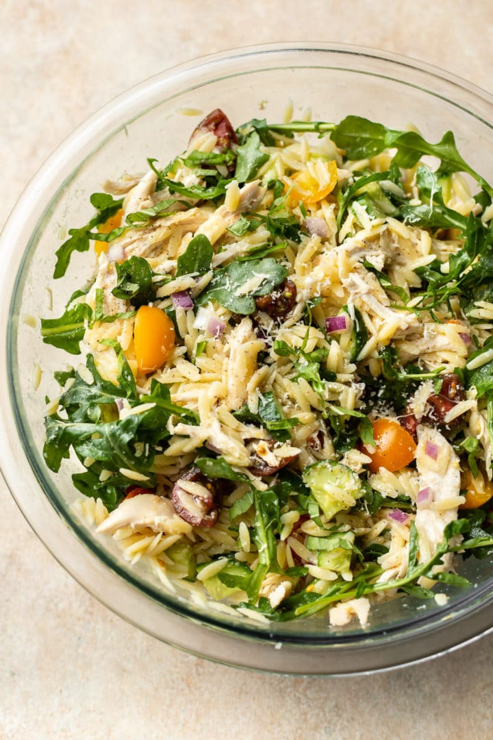 lemon orzo pasta salad with chicken in a glass prep bowl