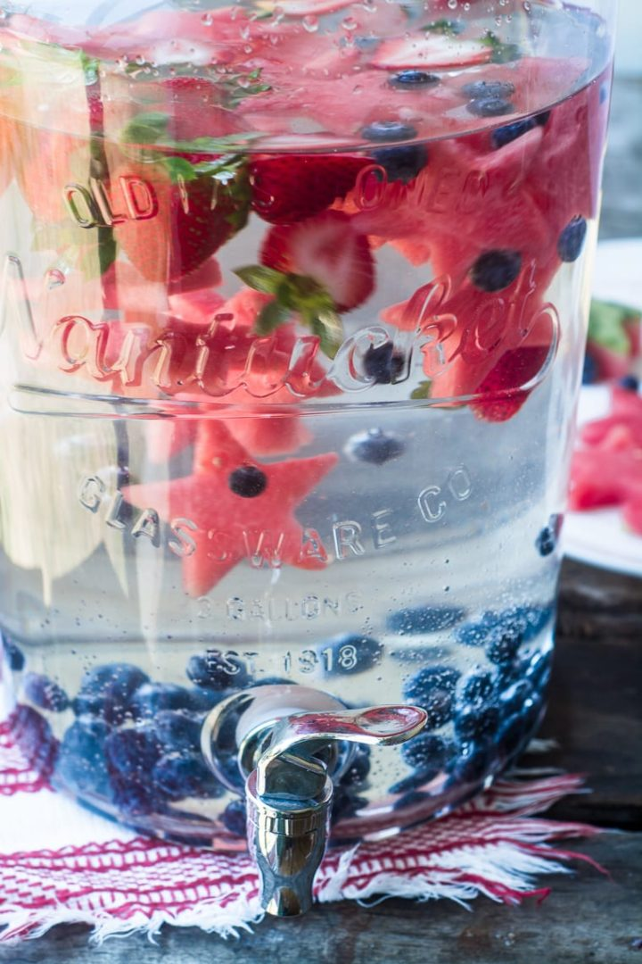 pitcher with patriotic cut out watermelon (star shapes) and blueberries