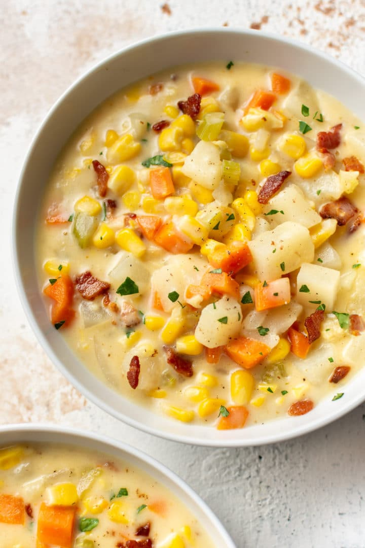 corn chowder in two white bowls