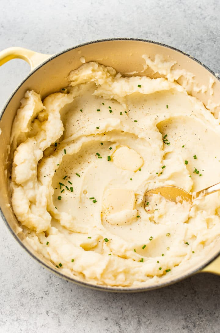 garlic mashed potatoes in a yellow Le Creuset pot