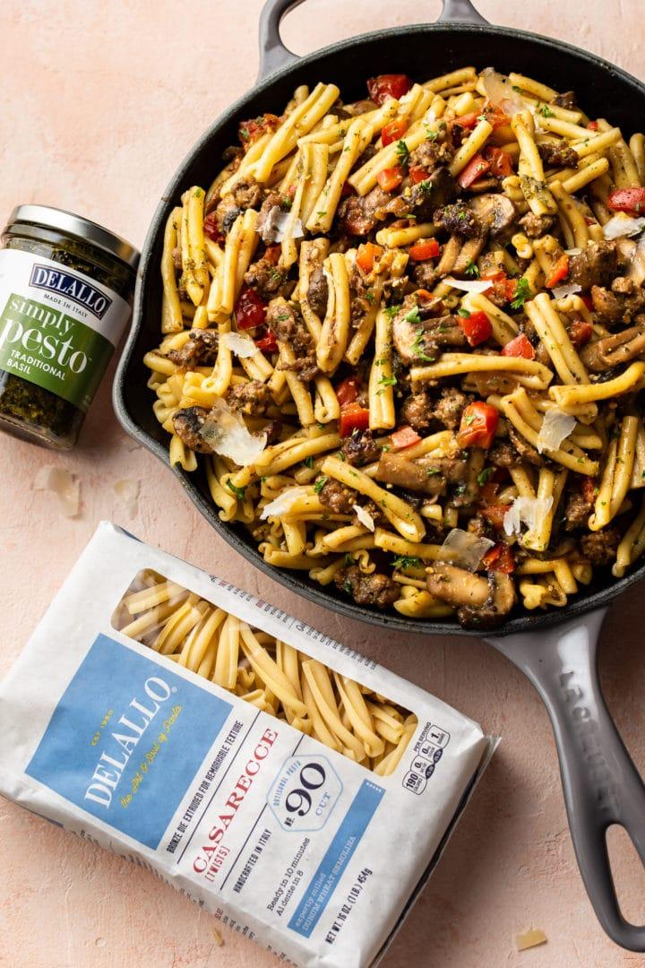 pesto sausage pasta in a skillet