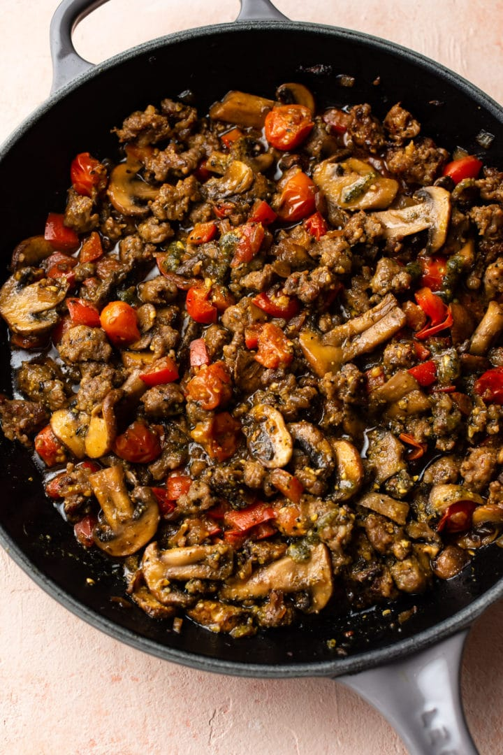 pesto sausage pasta sauce in a skillet