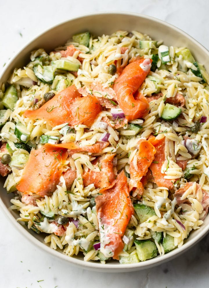 smoked salmon pasta salad in a beige serving bowl
