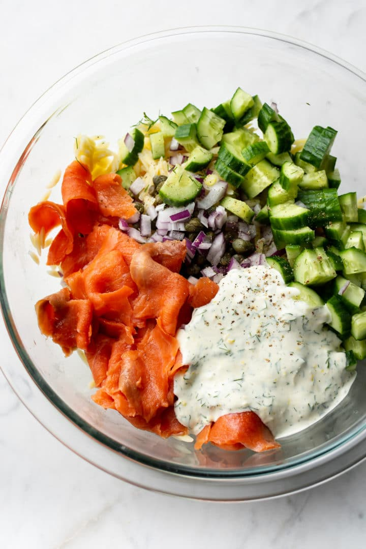 smoked salmon pasta salad ingredients in a glass prep bowl