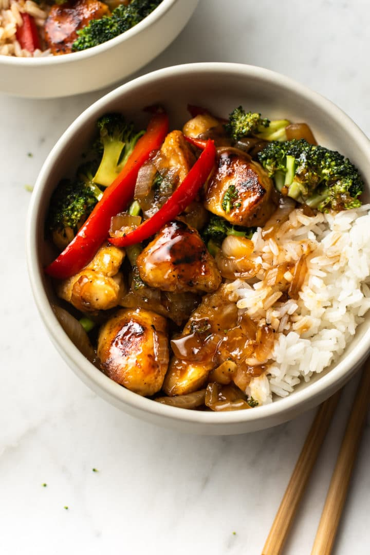 teriyaki chicken stir fry with rice in two bowls