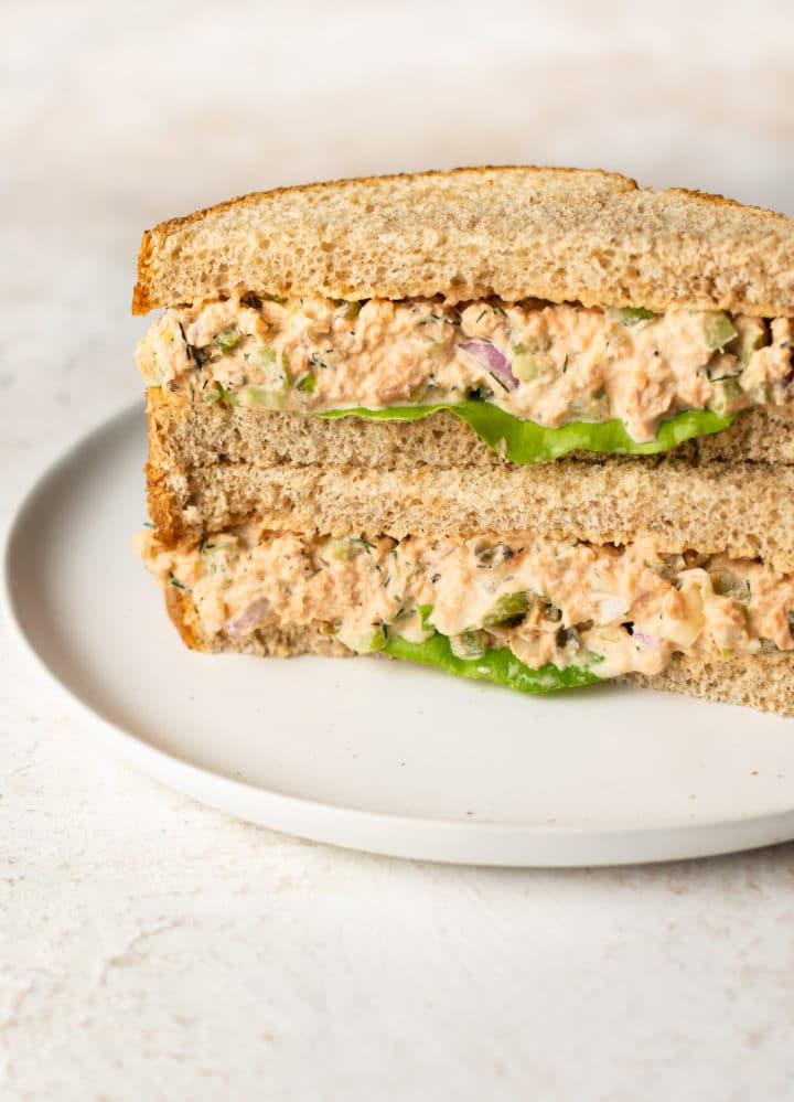 canned salmon salad sandwich (two halves stacked)