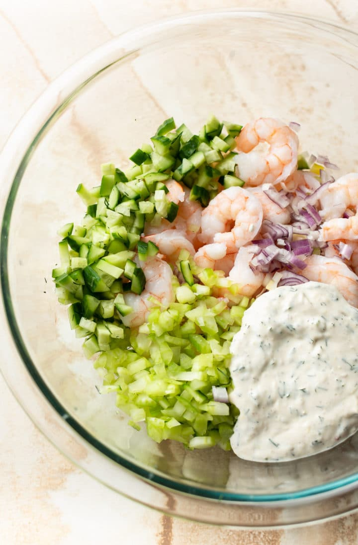 shrimp salad ingredients in a glass prep bowl