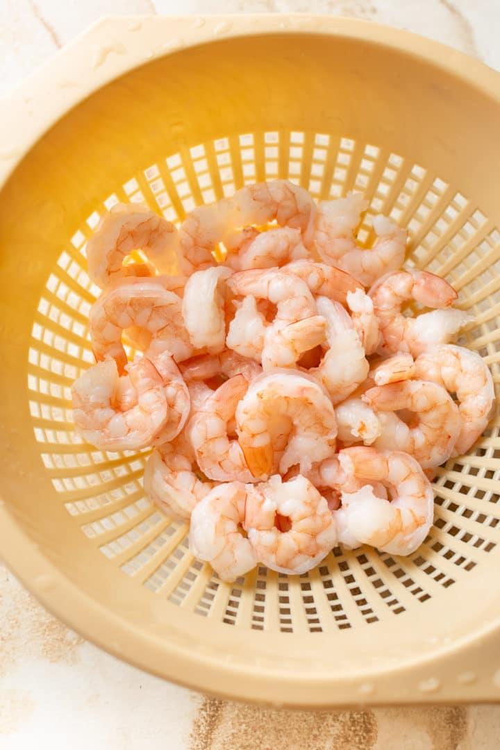 cooked shrimp in a colander