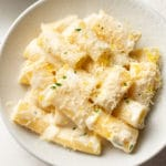 close-up of creamy lemon pasta in white bowl