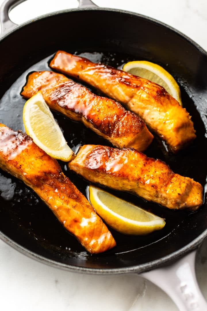 honey soy sauce glazed salmon in a skillet
