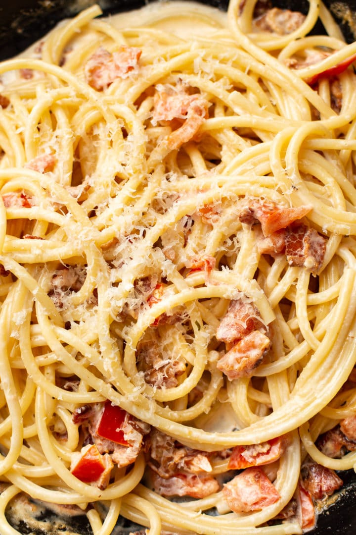 close-up of creamy tomato and bacon pasta