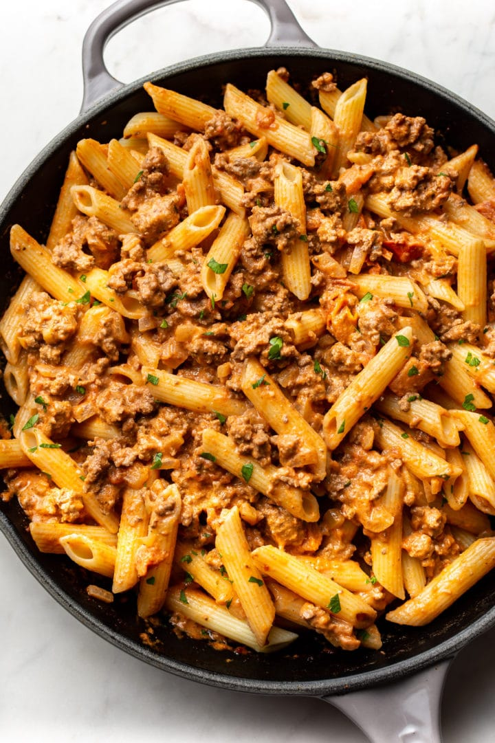 ground beef pasta in a skillet (sauce tossed with penne)