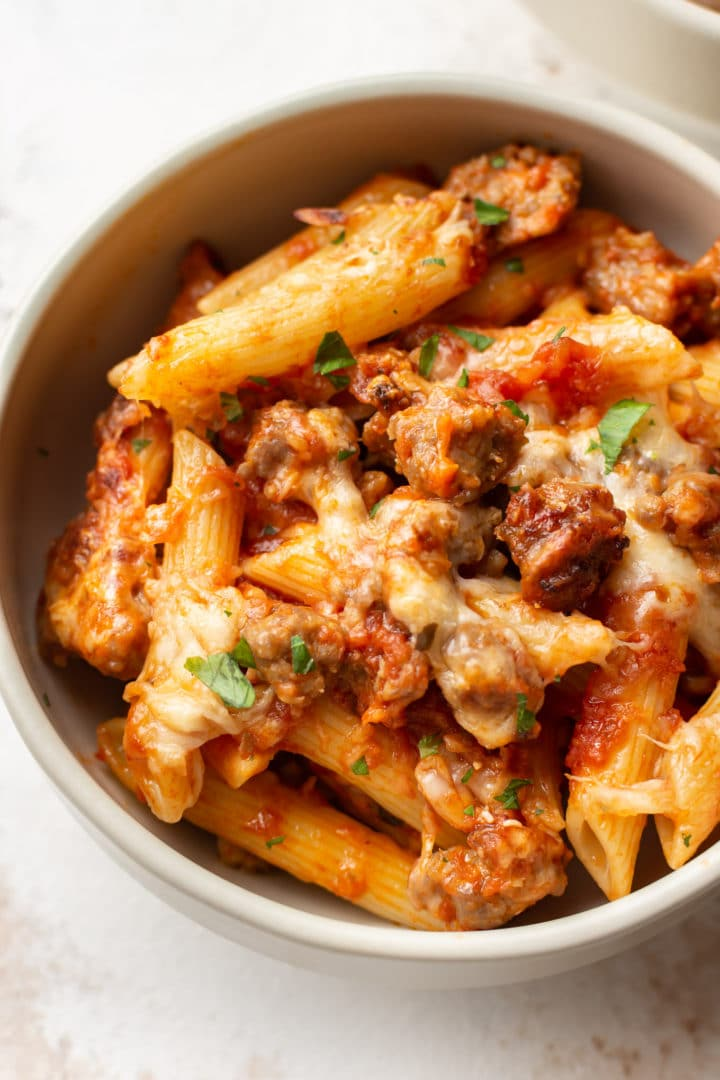 a bowl of baked penne with sausage