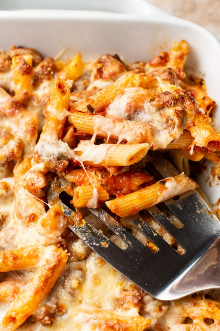 close-up of cheesy sausage penne bake (with cheese pull)