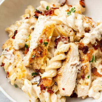 close-up of chicken bacon ranch pasta in a white bowl