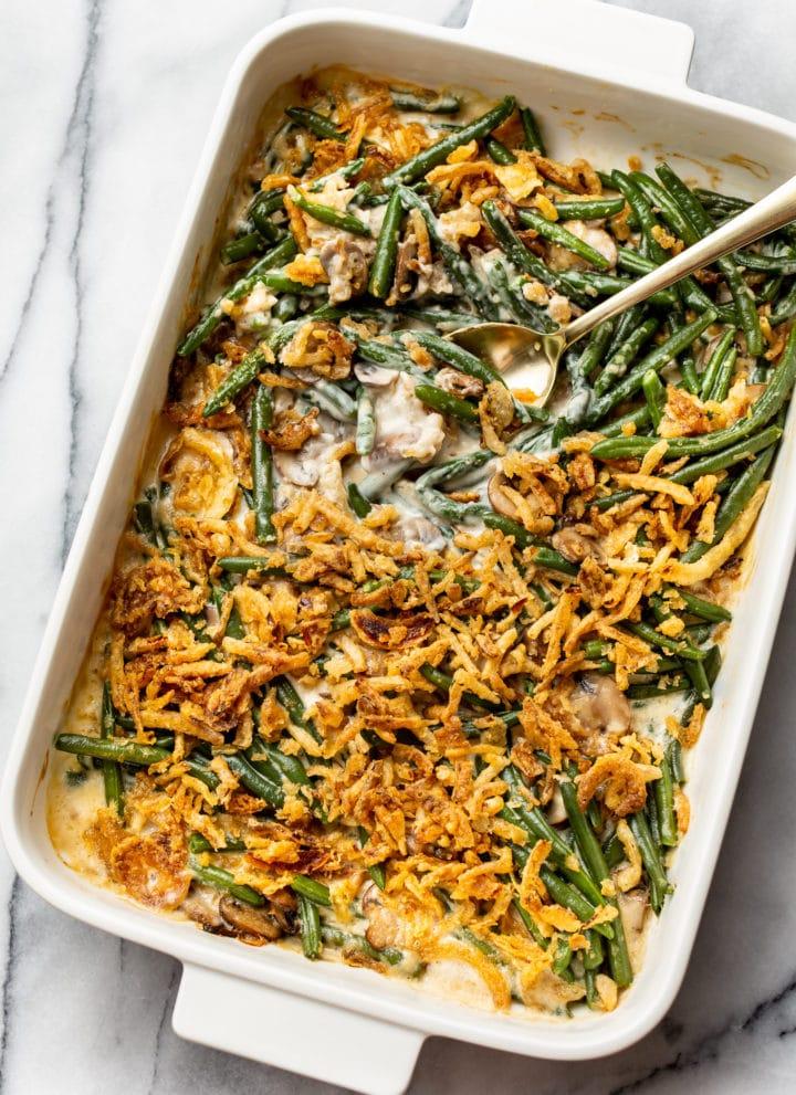 green bean casserole in a white 9x13 baking dish