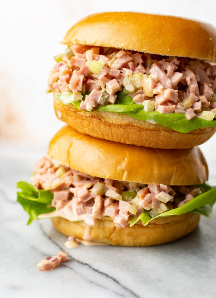 two ham salad sandwiches stacked on top of each other