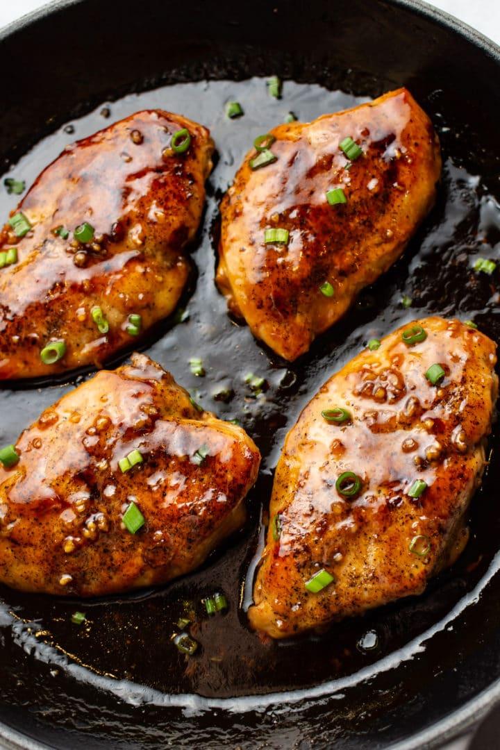 close-up of easy honey garlic chicken in a cast iron skillet