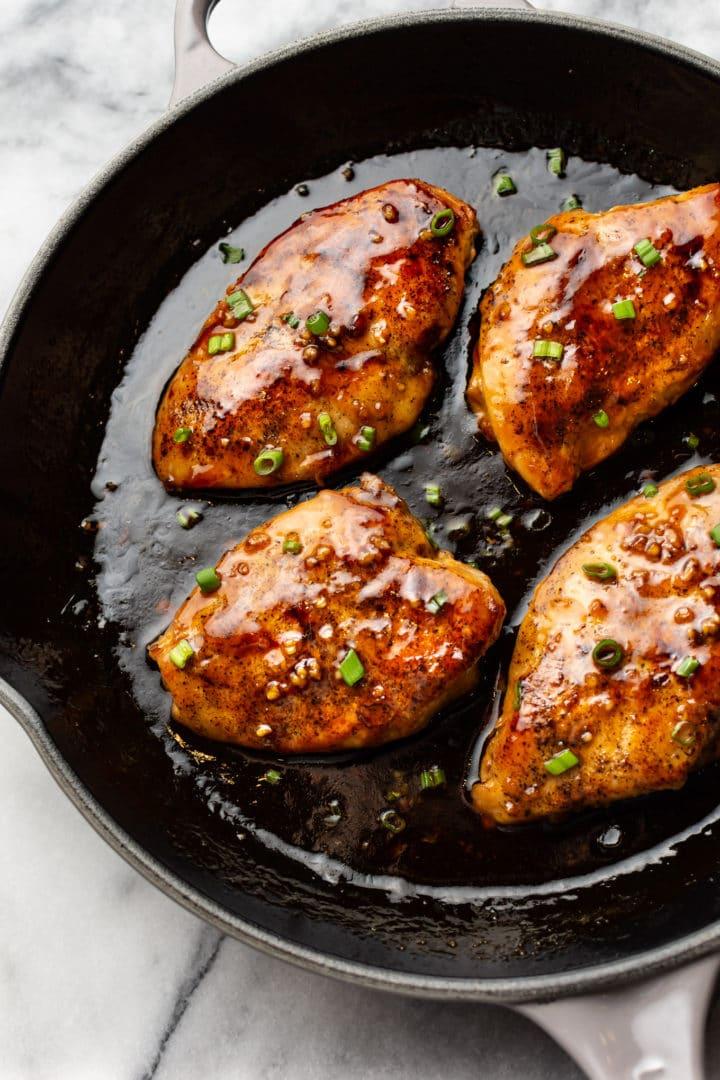 honey garlic chicken breasts in a cast iron skillet