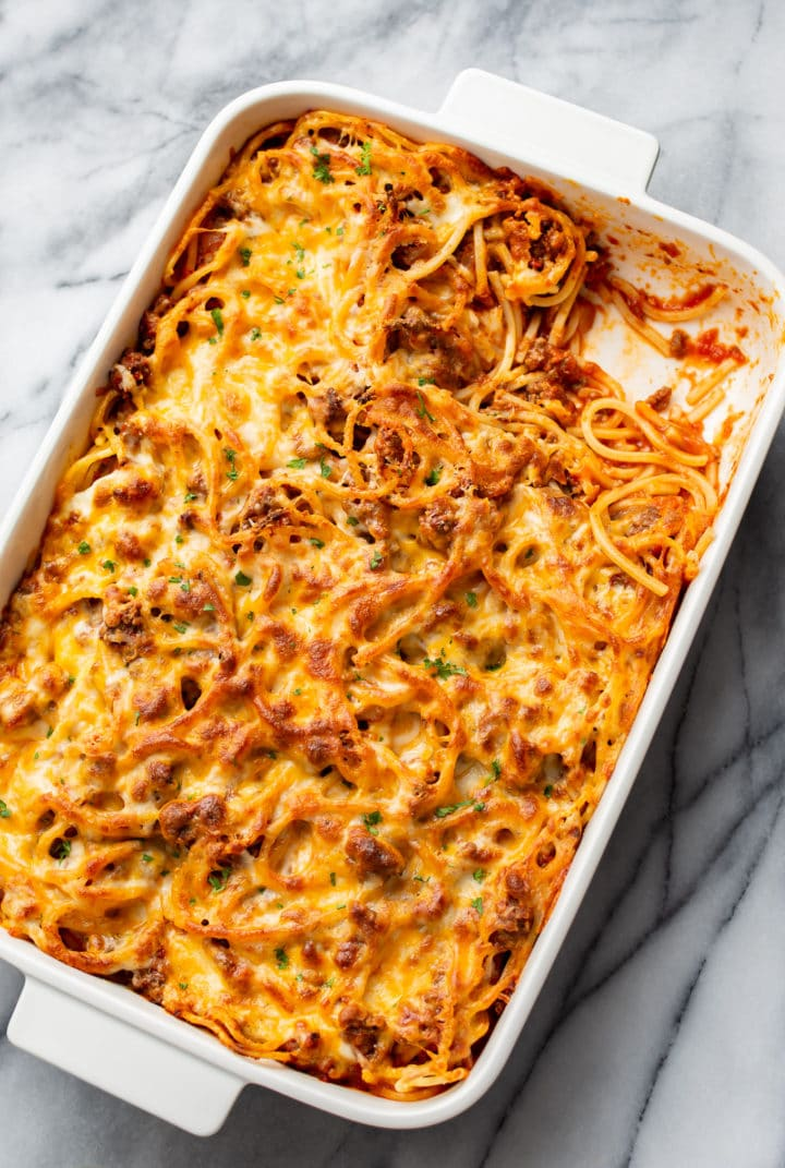the best baked spaghetti in a casserole dish with a corner piece taken out
