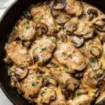 creamy mushroom pork tenderloin medallions in skillet