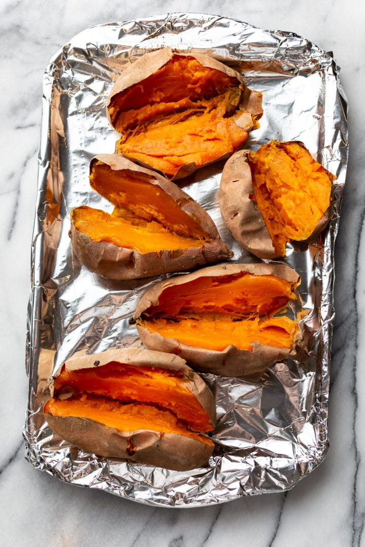 baked sweet potatoes on a baking sheet