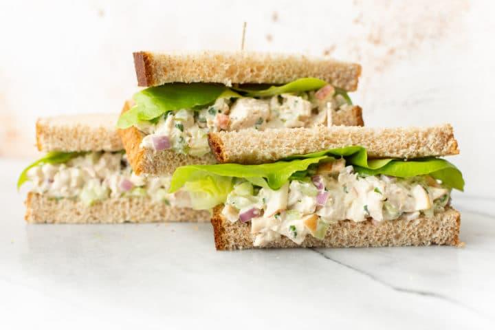 three homemade chicken salad sandwiches