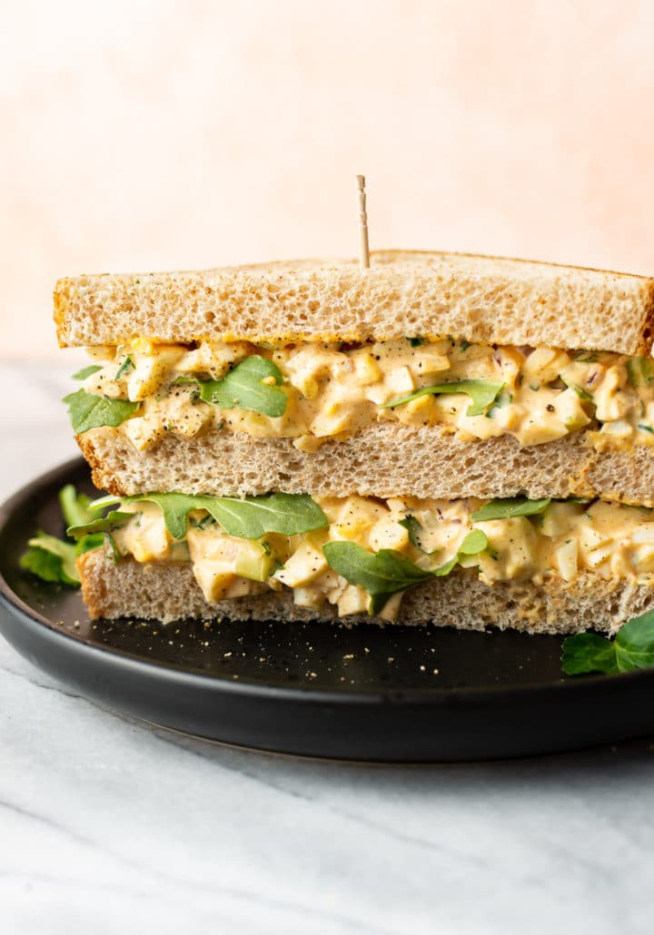 the best egg salad sandwich on a black plate
