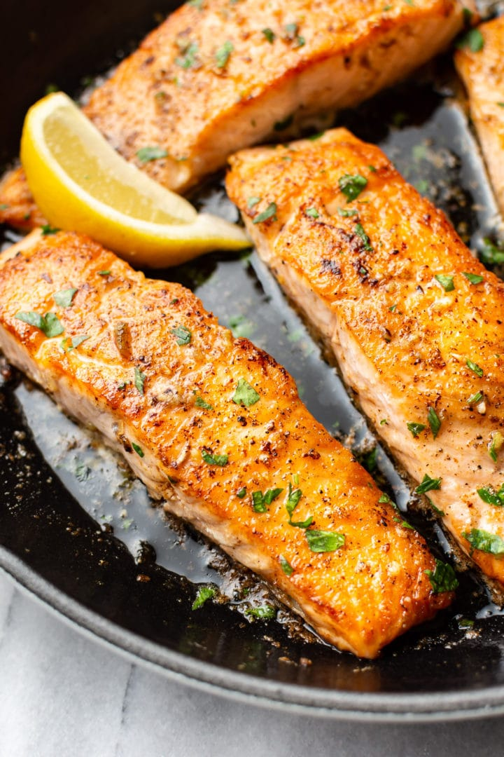 close-up of garlic butter salmon in a skillet