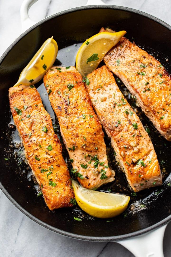 garlic butter salmon in a skillet