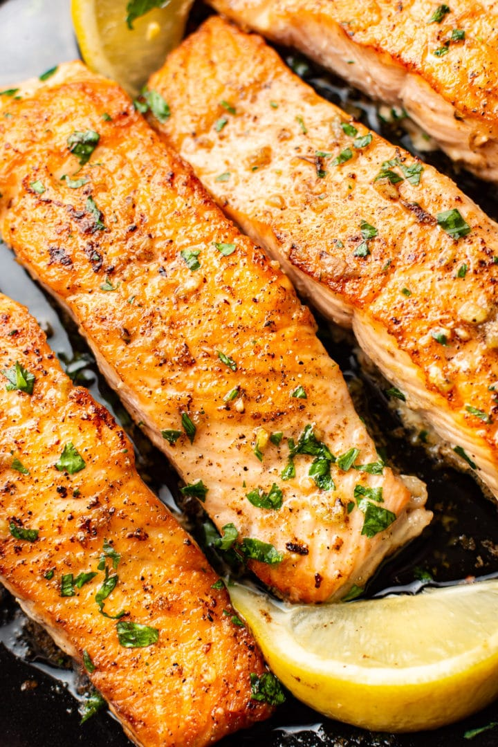 close-up of skillet garlic butter salmon