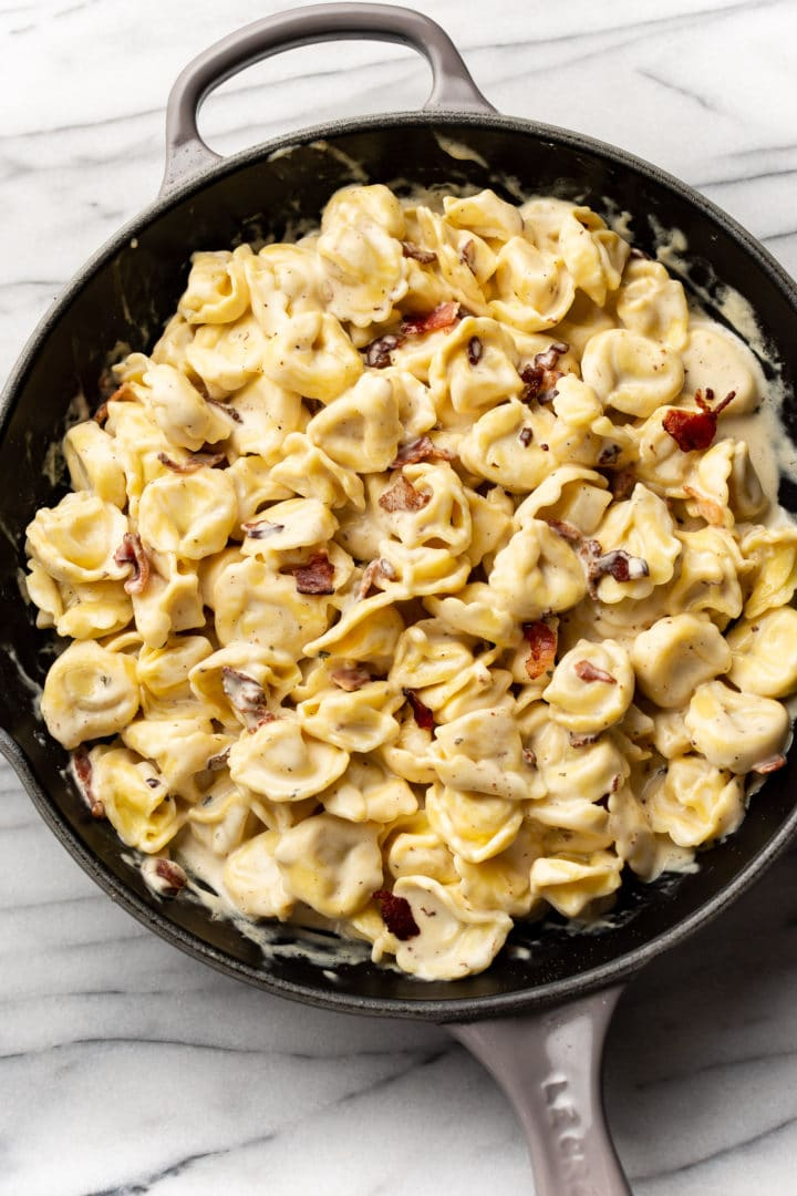 cream cheese tortellini with bacon and ranch in a skillet