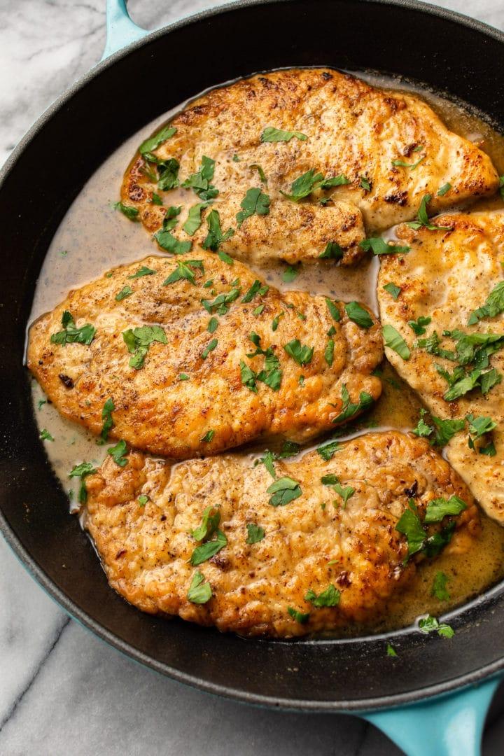 chicken scallopini in a skillet (close-up)