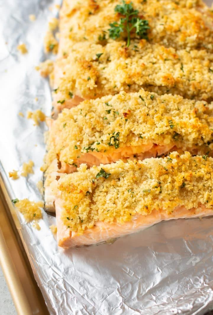 close-up of maple dijon breadcrumb baked salmon on a baking sheet