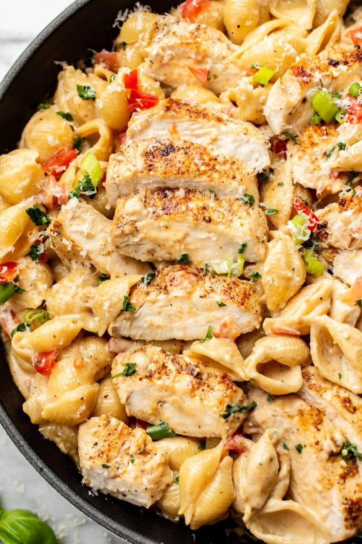 close-up of creamy Cajun chicken pasta in a skillet
