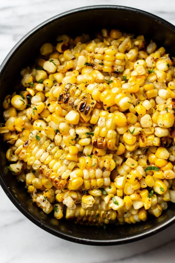 close-up of grilled corn kernels in a black bowl