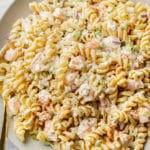 cold shrimp pasta salad in a shallow serving bowl