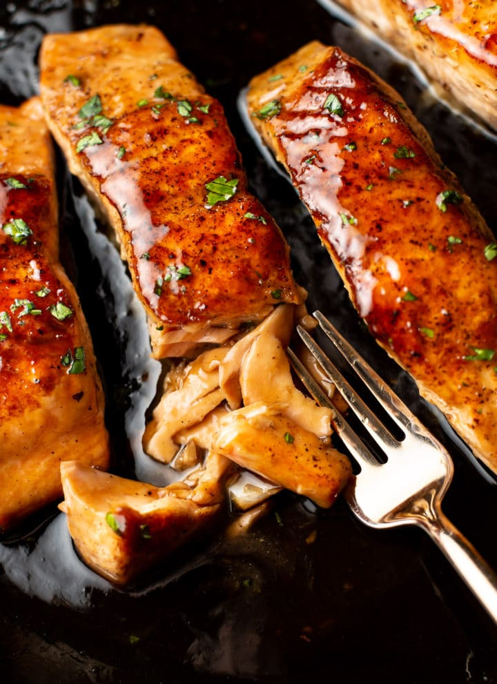 close-up of brown sugar glazed salmon flaked with a fork