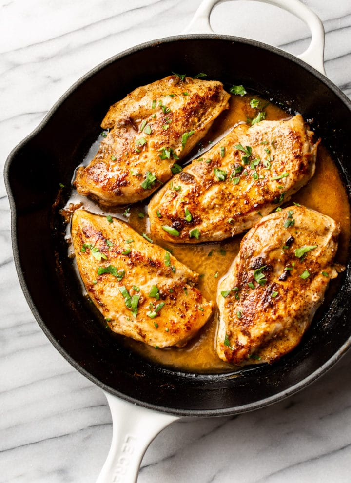 Cajun garlic butter chicken breasts in a skillet