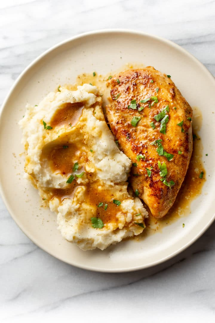 Cajun garlic butter chicken plated with mashed potatoes