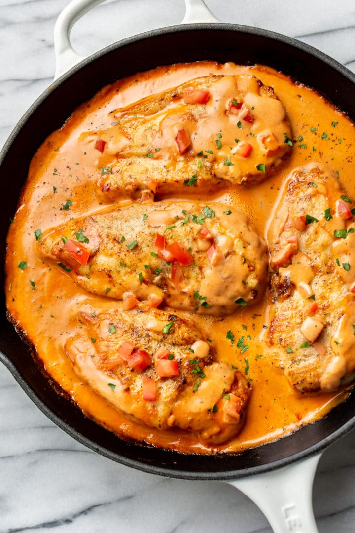 chicken in a tomato cream sauce in a skillet