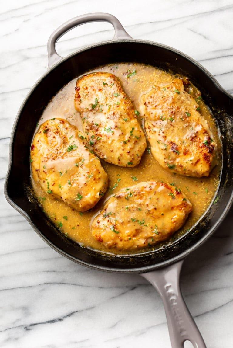 easy honey mustard chicken in a cast iron skillet