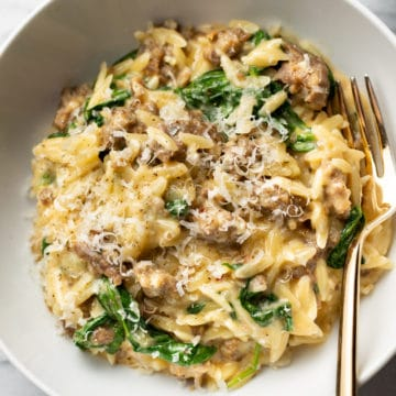 one pot orzo with Italian sausage in a white bowl