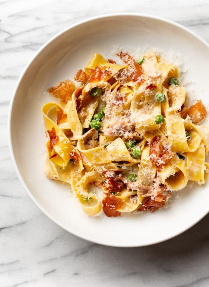 prosciutto pasta in a shallow bowl