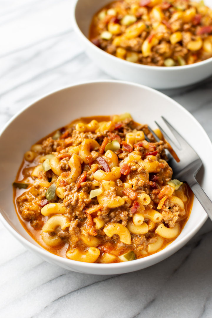 two white bowls with cheeseburger pasta