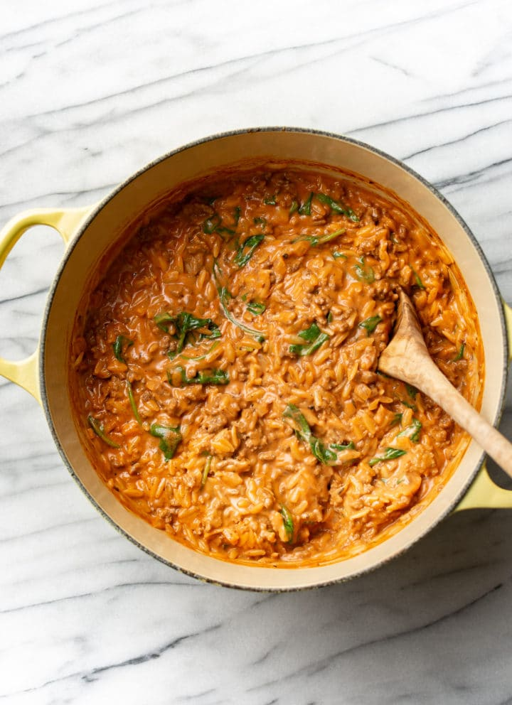 ground beef orzo in a yellow pot
