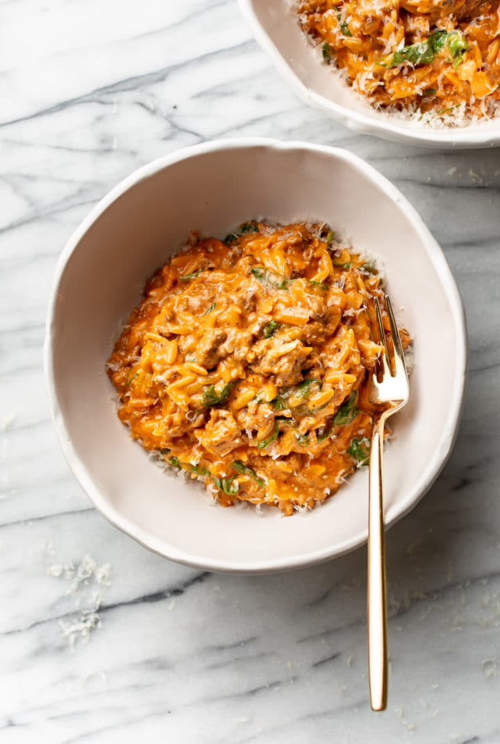 ground beef orzo in two white bowls