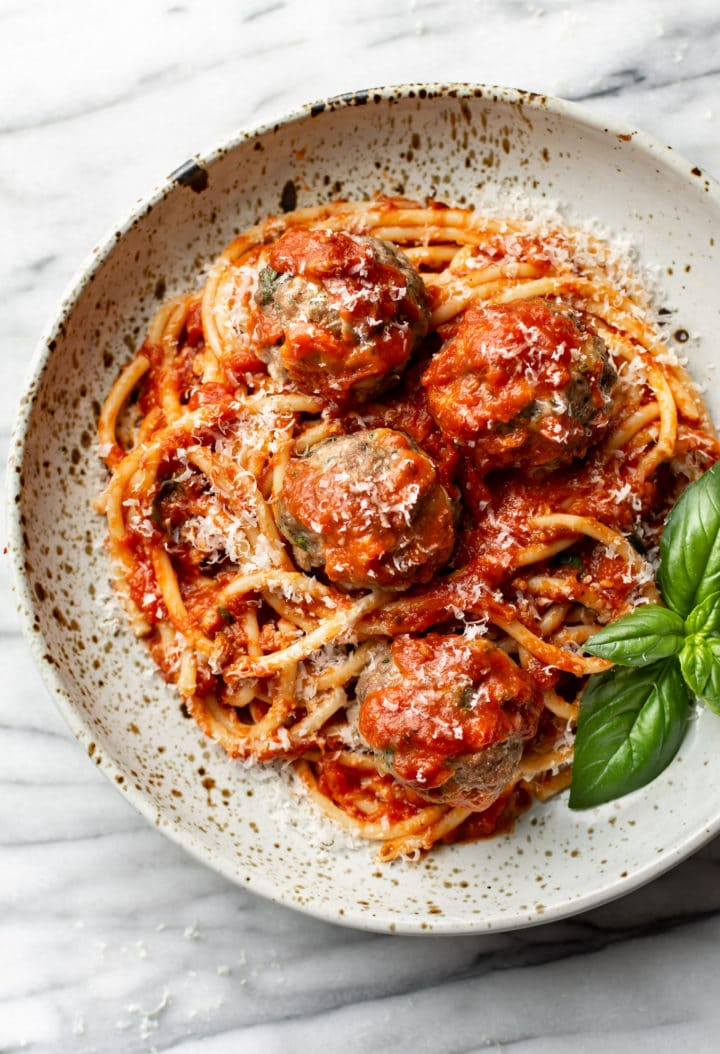 spaghetti and meatballs in a shallow bowl