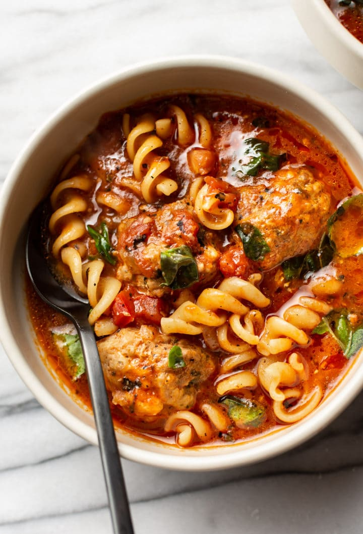 close-up of Italian meatball soup in a bowl